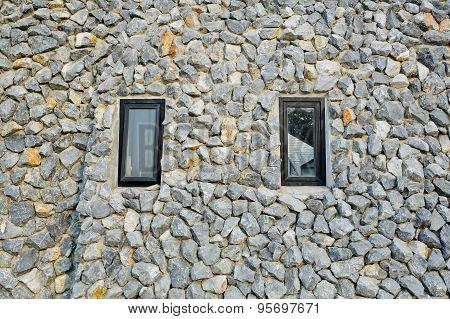 Rock Wall With Two Narrow Windows