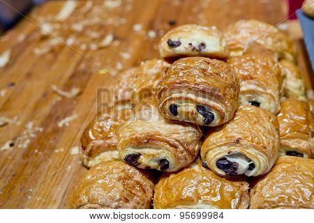 Sweet Rolls With Raisins On Cutting Board