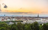 stock photo of torino  - Sunset on Torino (Turin) Piedmont Italy. Panoramic cityscape from above with Mole Antonelliana towering on the city and romatic colorful sky. Summer adventures in italian historical towns. ** Note: Visible grain at 100%, best at smaller sizes - JPG