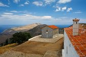 stock photo of hydra  - Greek church and a monastery on the top of a mountain on Hydra island - JPG