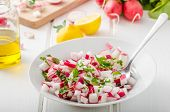 picture of radish  - Radish Spring salad with herbs fresh and delicious dressing from olive oil pepper salt and lemon juice and zest - JPG