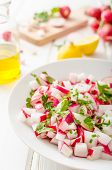 image of radish  - Radish Spring salad with herbs fresh and delicious dressing from olive oil pepper salt and lemon juice and zest - JPG