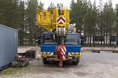 image of truck-cabin  - A truck with a crane for industrial and heavy lifting - JPG