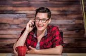 stock photo of enthusiastic  - Enthusiastic woman in business casual outfit on phone - JPG