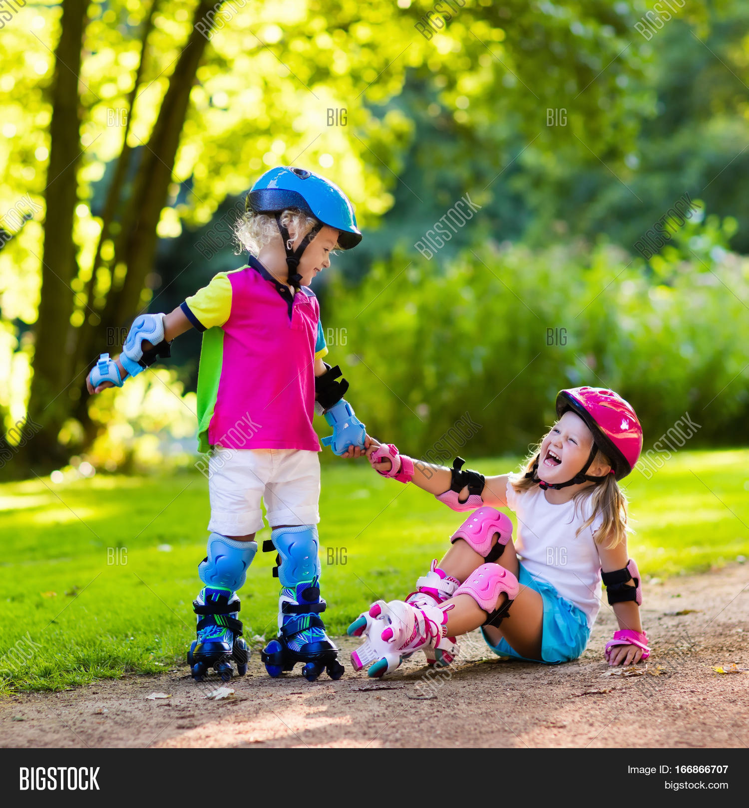 Helping Each Other: Girl Boy Learn Roller Skate Summer Image & Photo