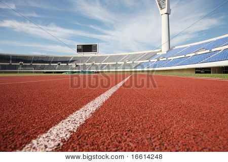 Empty stadium with grandstand and running track