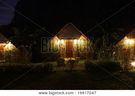 a photgraph of a country style cottage at night