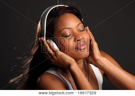 Beautiful woman enjoying music