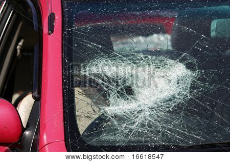 the smashed windscreen of a motor car
