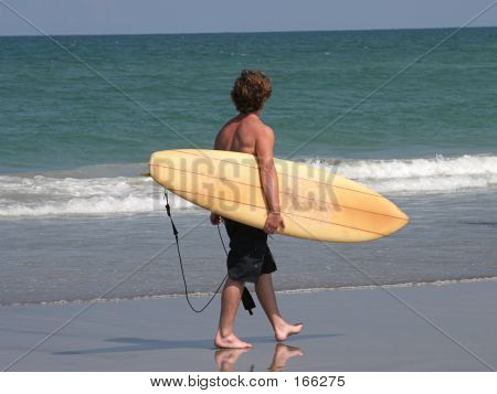 Surfer On Beach