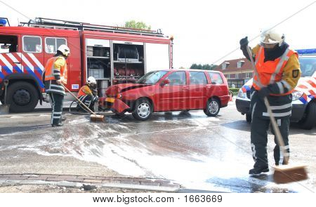 Firemen Cleaning Street After Car-Crash