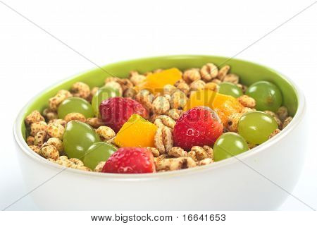 Fruit salad with cereal in bowl