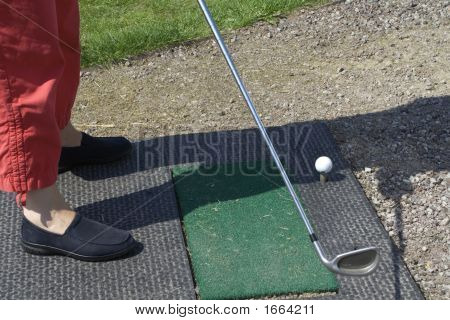 Hitting a golf ball on the artificial