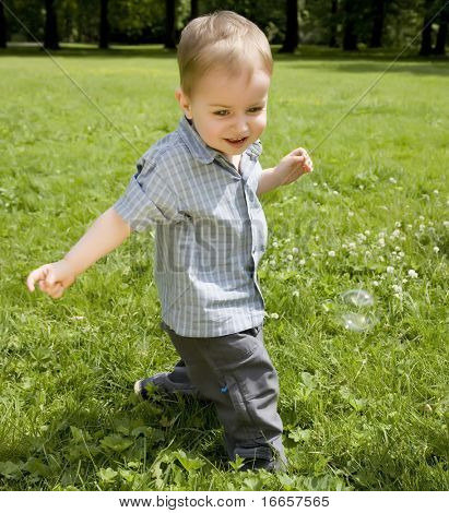 The Kid Running On A Green Meadow