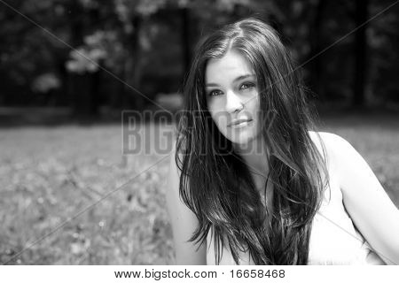 The Young Girl Sits On A Meadow. Monochrome Series.