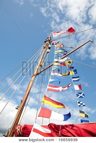 Mast And Flags On The Sky Background