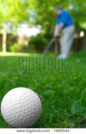 Golfball und golfer