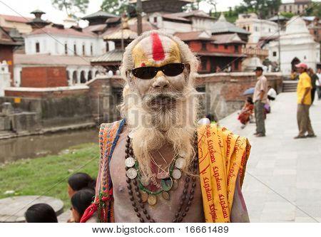KATHMANDU, NEPAL - JUNE 20: Old shaiva sadhu seeking alms in Pashupatinath on June 20, 2007 in Kathmandu, Nepal
