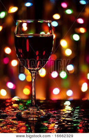 Wine glass in front of defocused lights