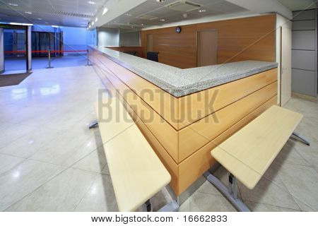 Reception desk on included in establishment, shallow depth of focus