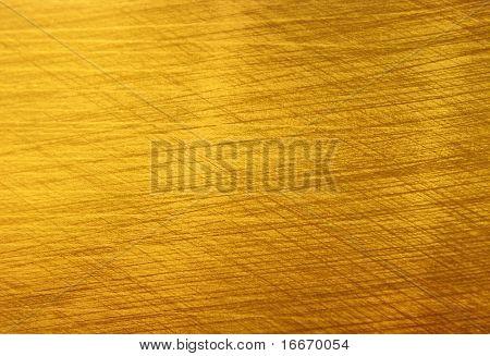 Textura de oro cepillado