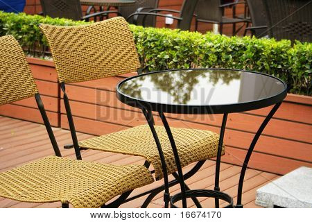 Coffee table with rattan chairs