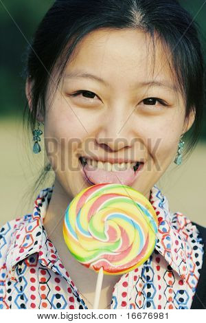 asian girl and her lollipop