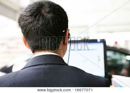 businessman's back before pc