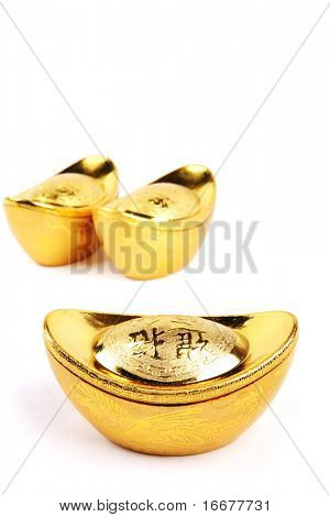 Decoration of chinese gold ingots in isolated white background