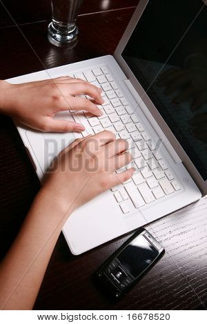 Close-up of secretary's hand touching computer keys during work