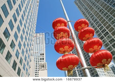 Red lantern and  skyscraper with blue sky in Beijing CBD(Central Business District),China. tradition   VS modern