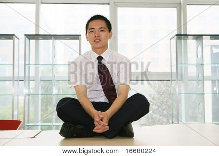 business man sit on table in offcie