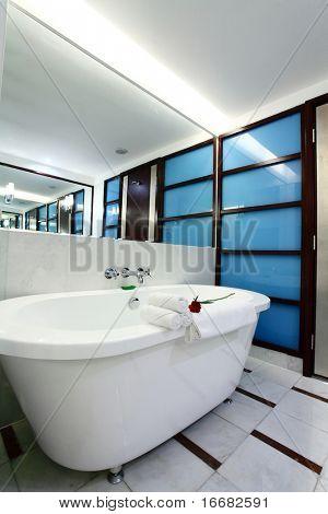 white bathtub with towel in bath room
