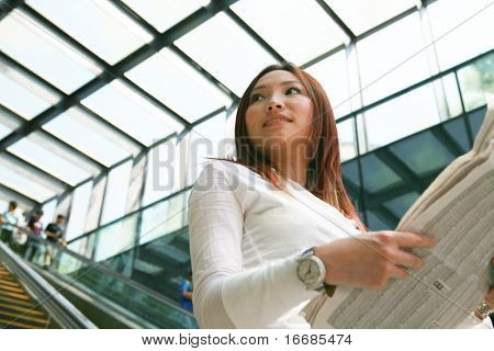 young asian business women reading newspaper