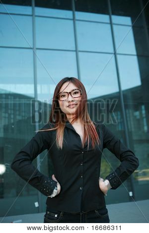 asian Businesswoman standing before office building