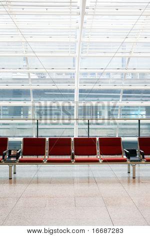 row of red chair at airport in Hongkong