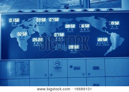 world map and time on wall in beijing airport