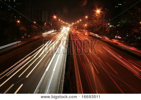 city by night:main roads with cars and reflections.