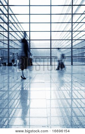 image of People silhouettes at morden office building