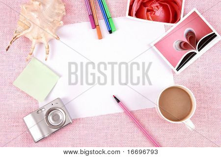 Clutter of objects stacked on pink background