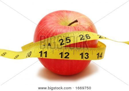 Red Apple And Measuring Tape  Isolated On White