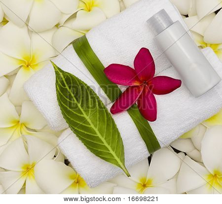 spa objecs with flowers towels on natural texture