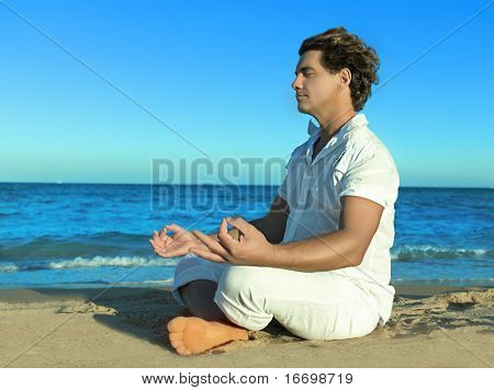 man  on the beach sitting meditating