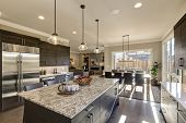 Постер, плакат: Modern Gray Kitchen Features Dark Gray Cabinetry