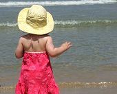 Cute Baby Looks At The Sea poster