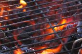 foto of barbie  - Just lighting the barbecue and the flames are coming up through the grill - JPG