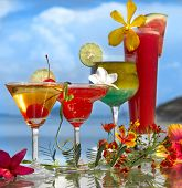 four cocktails on the beach