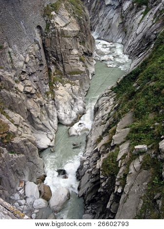 Furious mountain stream at St. Gotthard pass, Switzerland