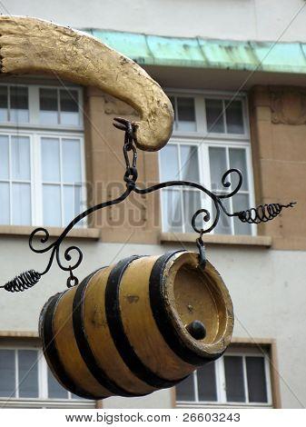 Hanging wine barrel against old building