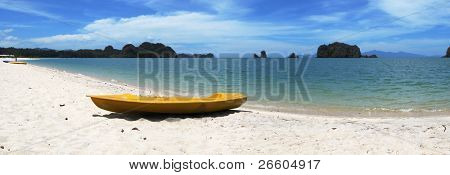 Yellow kayak on the famous Thanjung Rhu beach of Langkawi, Malaysia